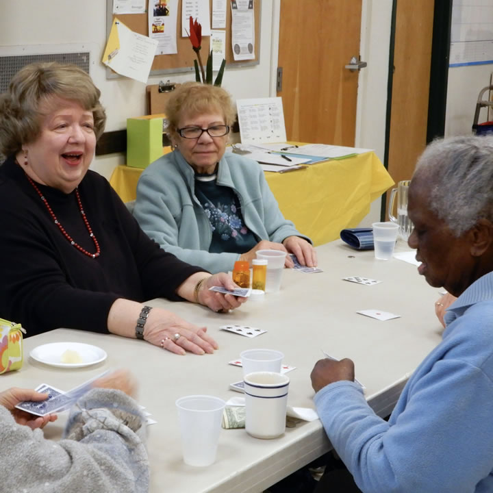 Seniors playing cards at the Eastwood Community Center.