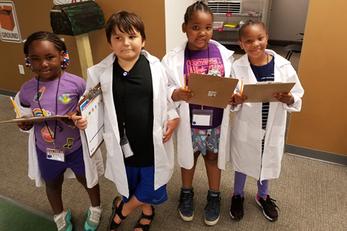 Kids practice being doctors at the County West Resource Center.