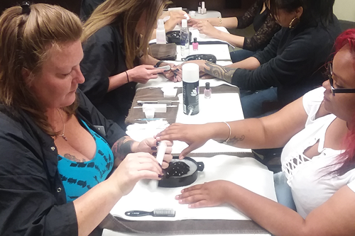 Mothers get free manicures and pedicures for Mother's Day