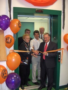 ribbon cutting ceremony on elevator with group of people