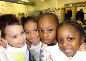 group of four smiling children