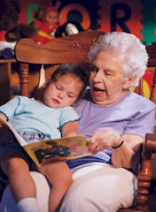 foster grandmother reading to girl