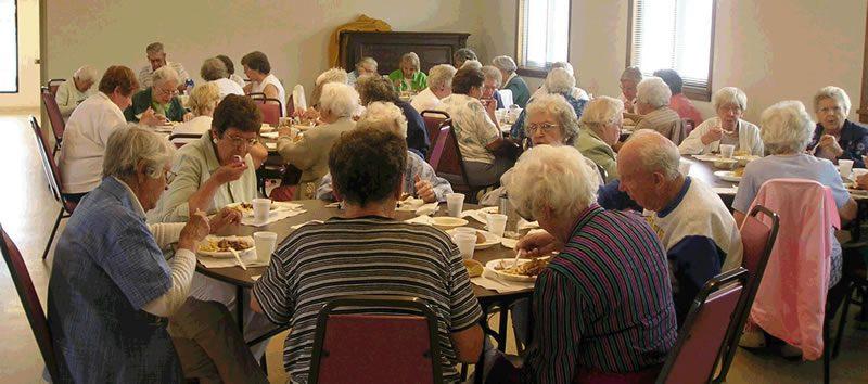 seniors eating at tables